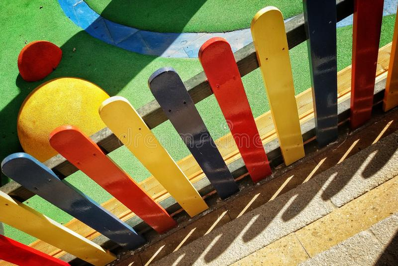 Multi-Coloured Fence by Play Area. Multi Coloured Fence stock photography