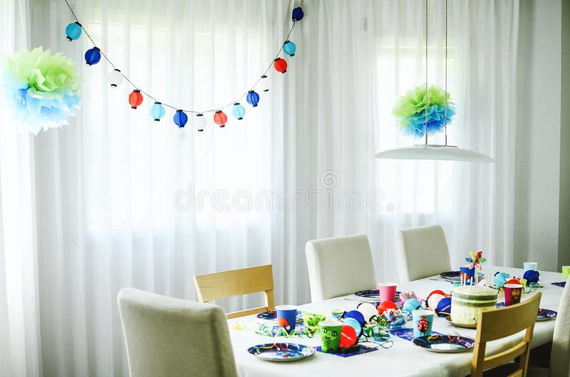 Multi-coloured kids birthday party Rainbow themed. Decorated tab royalty free stock photo