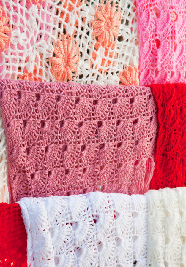 Multi-coloured knitted scarfs. A traditional product of Russian national crafts royalty free stock photo