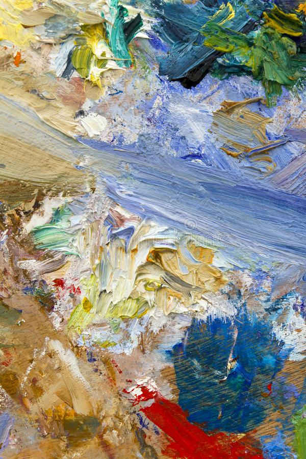 Multi-coloured palette. Vibrant multi-coloured artists oil or acrylic paints palette semi abstract close-up stock photo