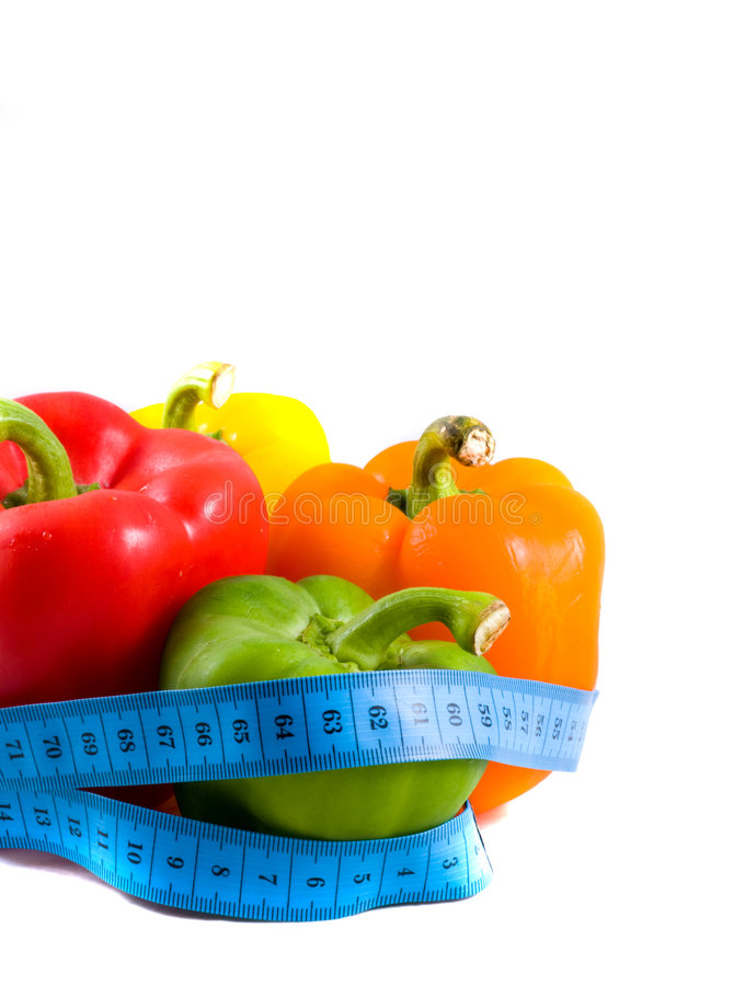 Multi-coloured pepper. With measuring tape. Isolation stock photo