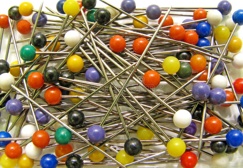 Multi coloured pins for craft and hobbies stock photography