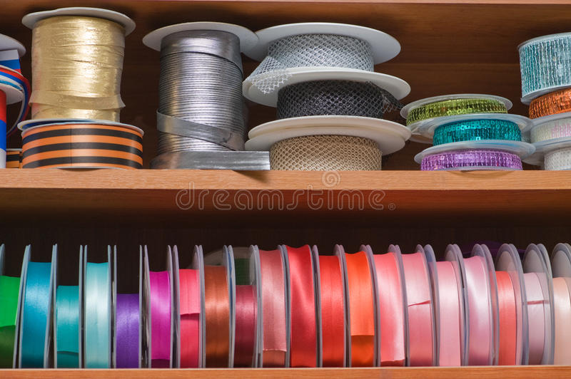Multi coloured ribbon. Multi-coloured ribbons on bobbins stock images