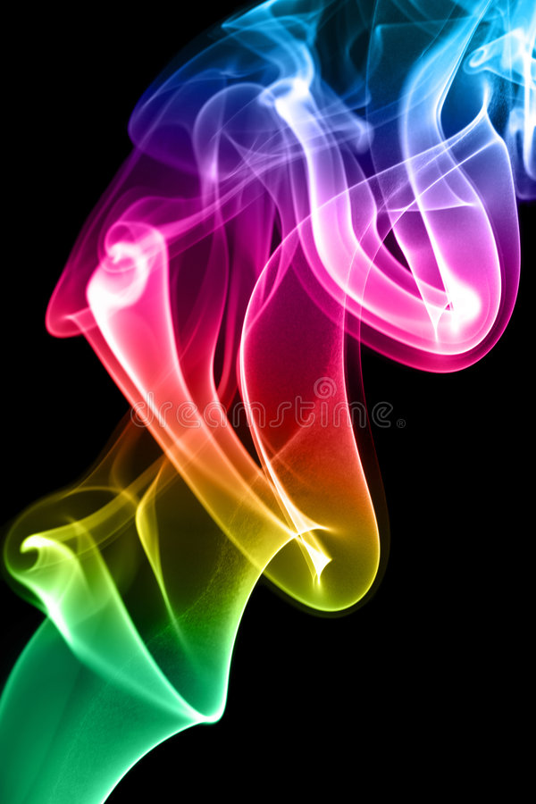 Multi-coloured smoke. Background. Multi-coloured smoke on a black background royalty free stock photo