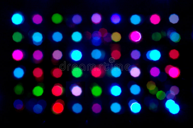 Multi-coloured spots. On a black background stock photography