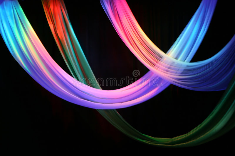 Multi-coloured stage draperies. Against dark background stock images