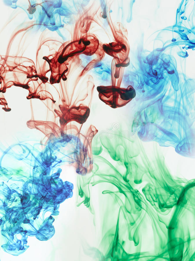 Multi-coloured substances dissolving in water stock photography
