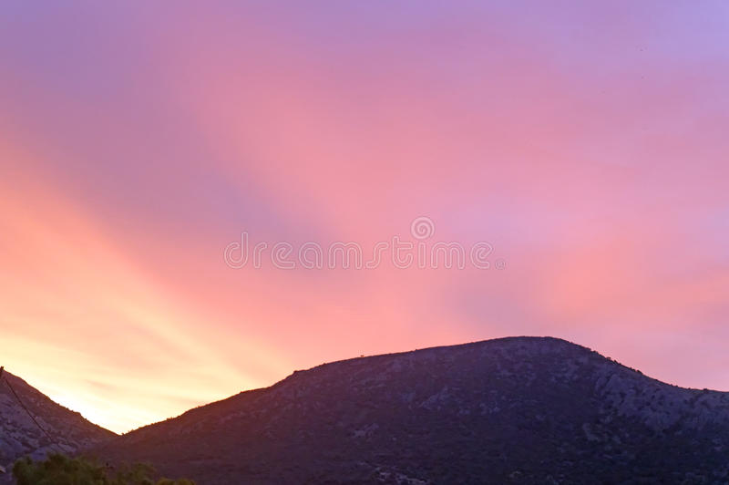 Multi-Coloured Sunrise Over Mountain royalty free stock images