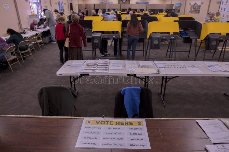 multi-cultural citizens vote on Super Tuesday Presidential Primary at the Iman Cultural Center, LA, CA stock photos