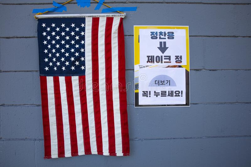 multi-cultural citizens vote on Super Tuesday Presidential Primary at Korean Elementary School royalty free stock images