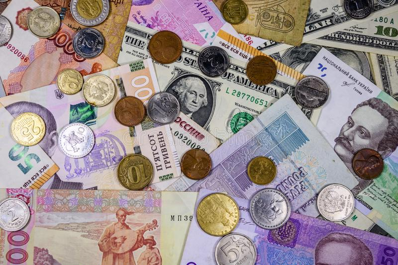 Multi currency background. Euro, american dollars, ukrainian hryvnias, egyptian pounds, russian roubles, different coins. Multi currency background. Euro stock photography