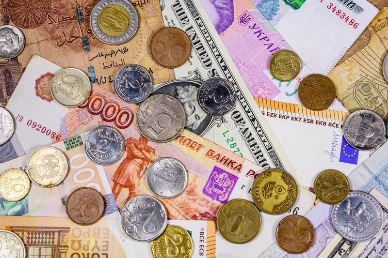 Multi currency background. Euro, american dollars, ukrainian hryvnias, egyptian pounds, russian roubles, different coins. Multi currency background. Euro stock photo