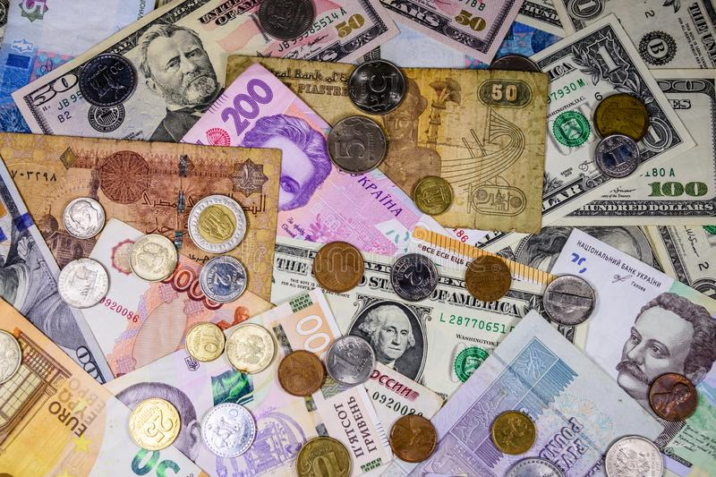 Multi currency background. Euro, american dollars, ukrainian hryvnias, egyptian pounds, russian roubles, different coins. Multi currency background. Euro royalty free stock images
