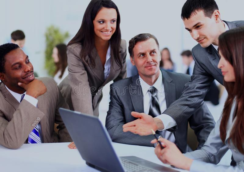 Multi ethnic business executives at a meeting discussing a work. stock photo