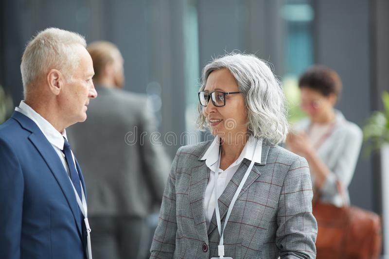 Multi-ethnic business forum participants in lobby royalty free stock image
