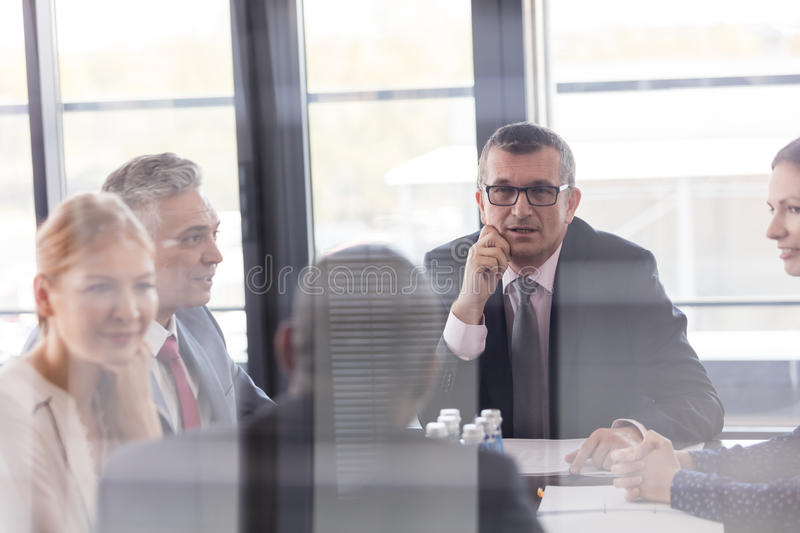 Multi-ethnic business people having discussion in board room at office royalty free stock photography