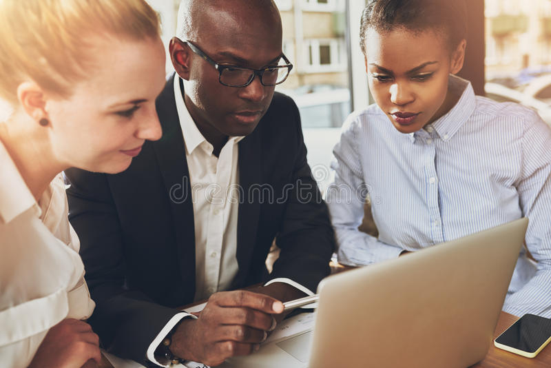 Multi ethnic business people working at office stock image