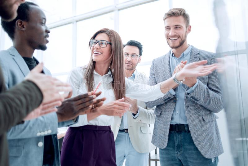 Multi-ethnic business team applauding to speaker after presentation on new project royalty free stock photos