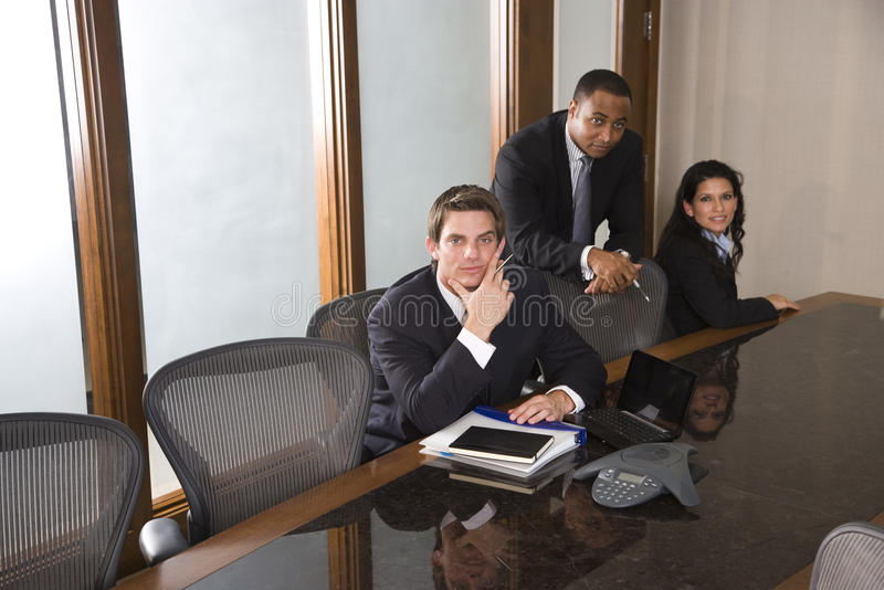 Multi-ethnic business team in boardroom royalty free stock photo