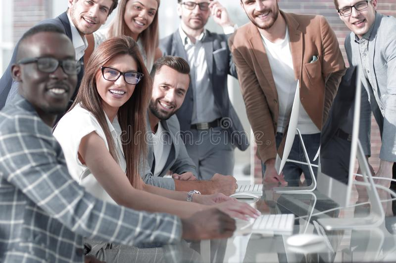 Multi-ethnic business team discusses the results of its work stock images