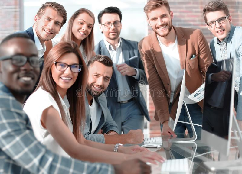 Multi-ethnic business team discusses the results of its work stock image