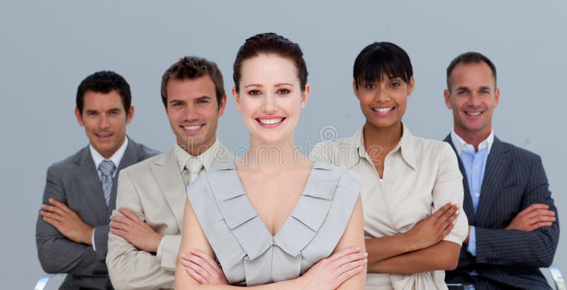 Multi-ethnic business team with folded arms. Smiling multi-ethnic business team with folded arms stock photography