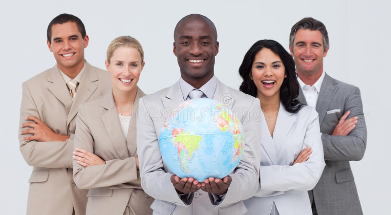 Multi-ethnic business team holding a terrestrial g stock photo