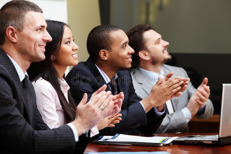 Multi ethnic business team at a meeting stock photo