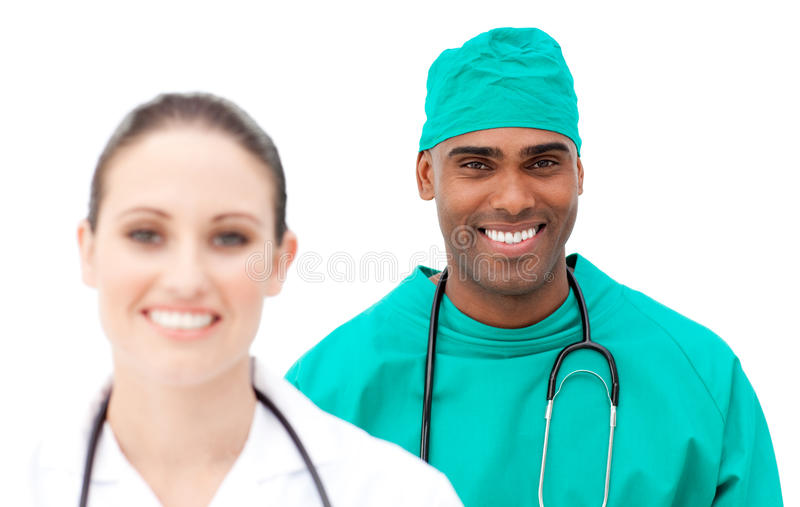 Multi-ethnic doctors standing in a row stock images