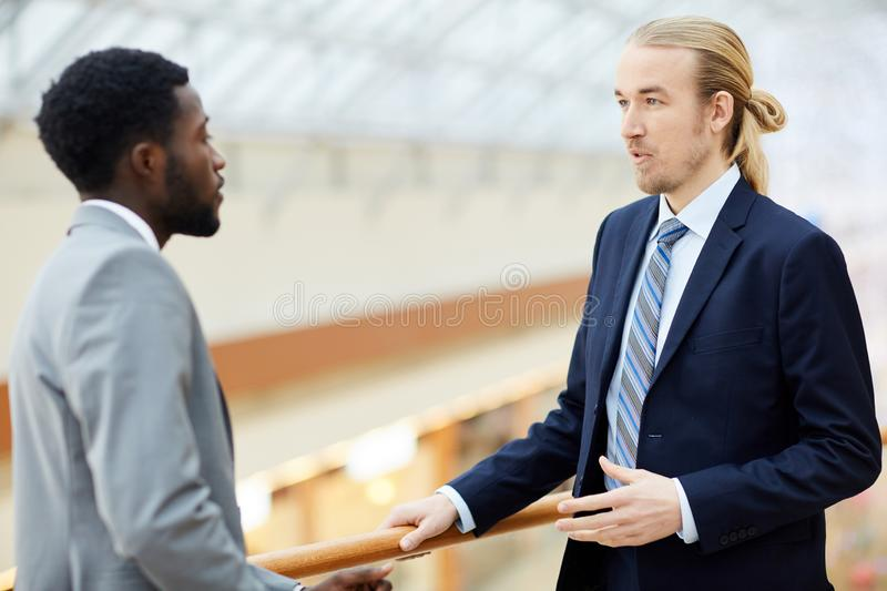 Multi-ethnic executives discussing business royalty free stock photo