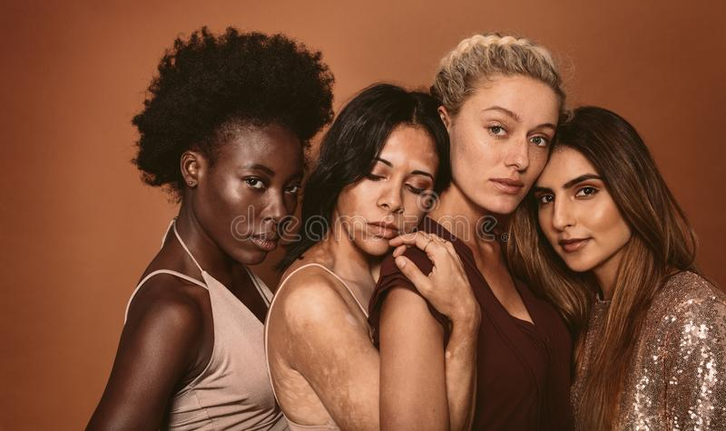 Multi ethnic females with different skin types stock image