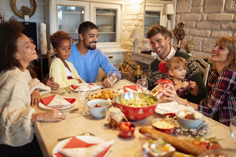 Multi ethnic friends have fun at a family Christmas dinner royalty free stock photo