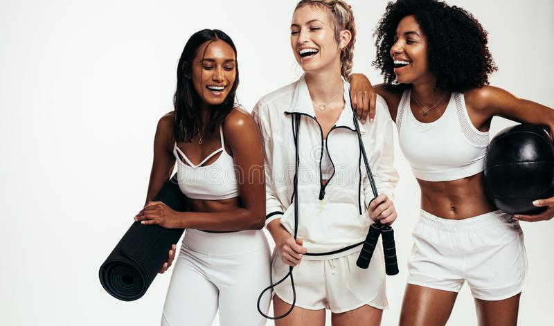 Multi-ethnic friends taking break from workout stock photos