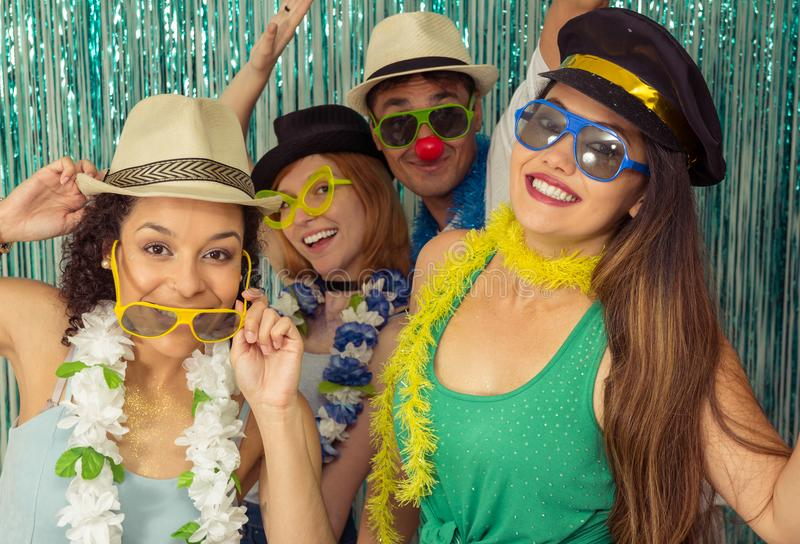 Partygoers are celebrating Carnival in Brazil. Much joy and fun. Multi ethnic group of Brazilian friends. Costumed revelers are happy and celebrating the stock photography