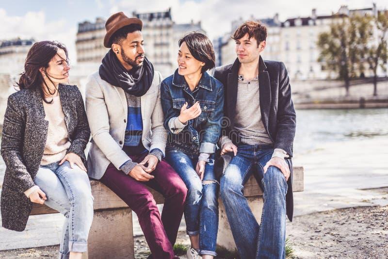 Multi-ethnic Group Of Friends Having Fun In Paris Along Seine stock photos
