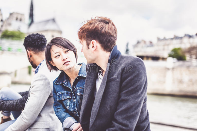 Multi-ethnic Group Of Friends Having Fun In Paris Along Seine royalty free stock image