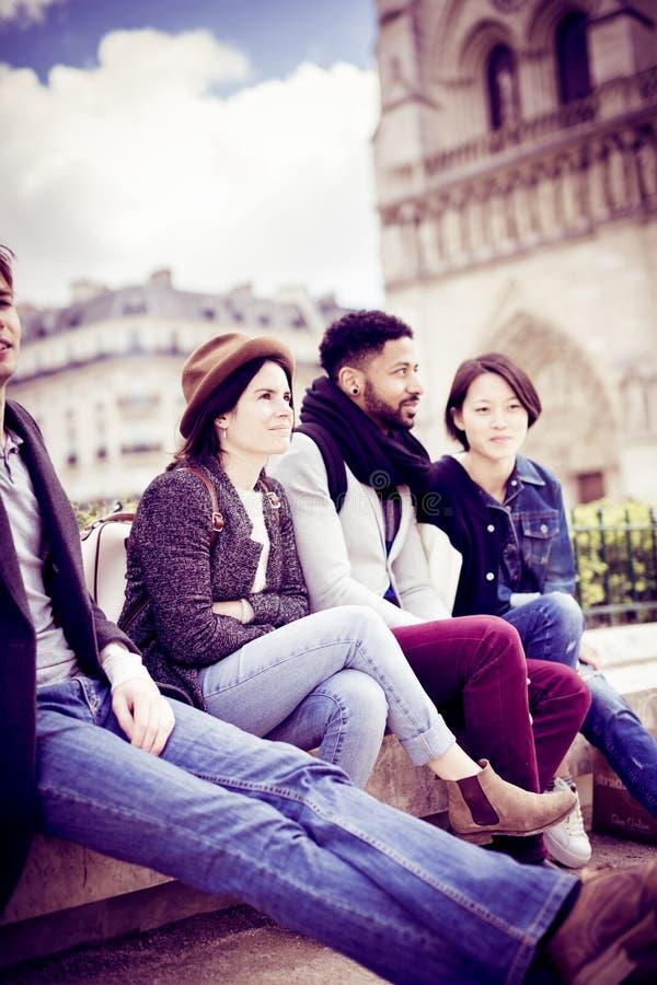 Multi-ethnic Group Of Friends Having Fun In Paris, Notre Dame stock image