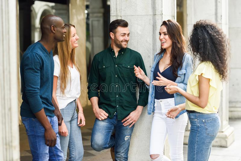 Multi-ethnic group of friends having fun together in urban background royalty free stock photos