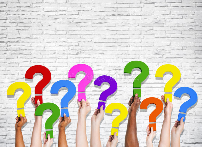 Multi-Ethnic Group of Human Hands Holding Question Marks.  royalty free stock image
