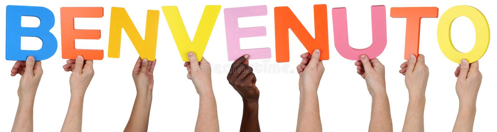 Multi ethnic group of people holding the Italian word Benvenuto stock images