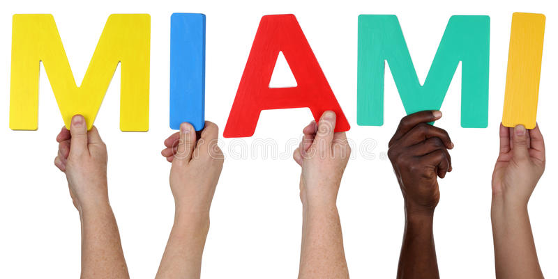 Multi ethnic group of people holding the word Miami royalty free stock images