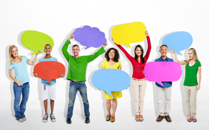 Multi-Ethnic Group of People with Speech Bubbles royalty free stock images