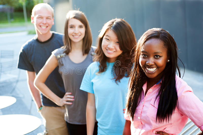 Multi-ethnic group of teenagers. Outside smiling