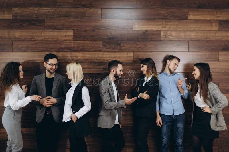 Multi-ethnic millennial people holding phones and resumes preparing for job interview, diverse vacancy applicants candidates wait stock photography