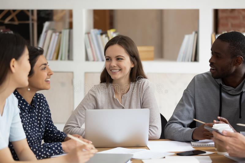 Multi-ethnic students sitting at classroom desk study together royalty free stock image