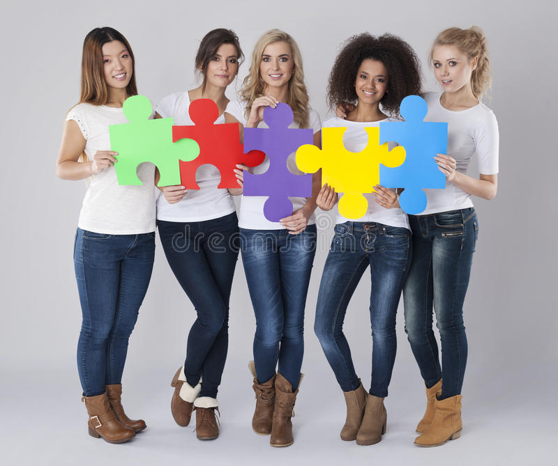 Multi ethnic women puzzles royalty free stock photography