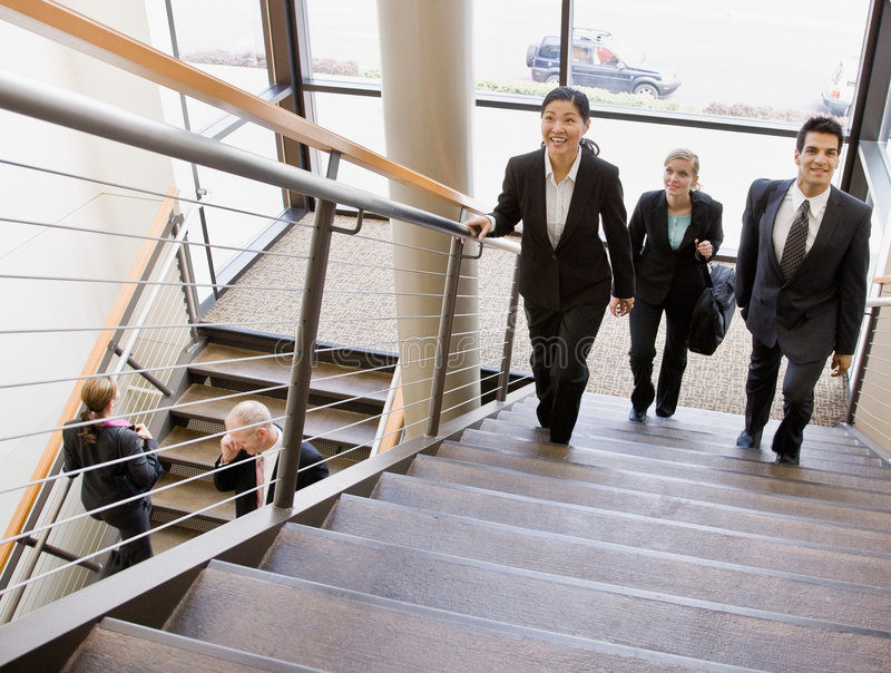 Download Multi-ethnic Workers Ascending Office Stairs Royalty Free Stock Photography - Image: 6604627