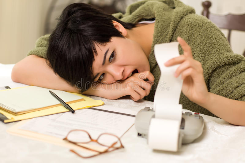 Multi-ethnic Young Woman Agonizing Over Financials stock photos