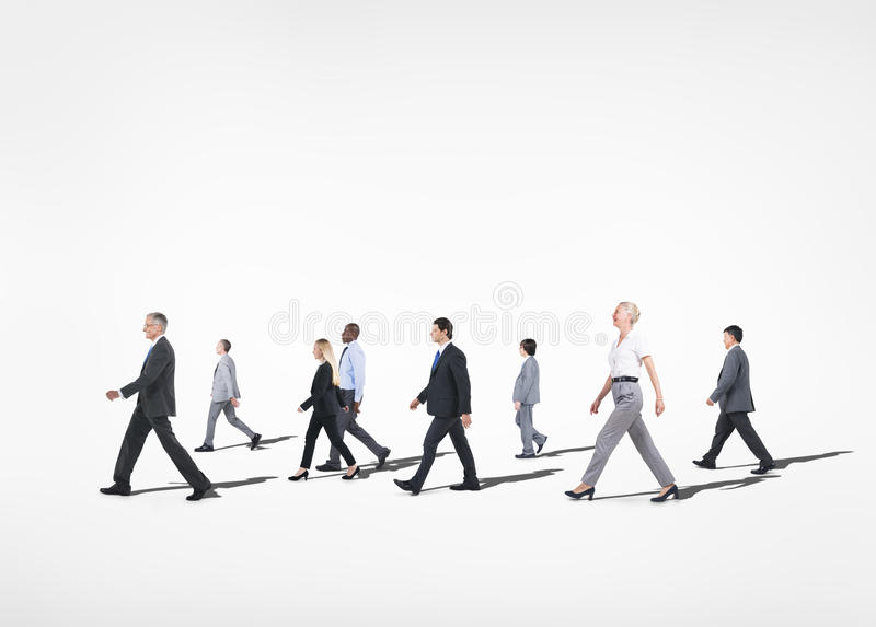 Multi-Ethnical People Walking in White Background stock photo