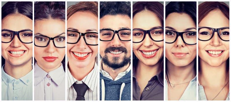 Multi-etnische groep gelukkige jonge vrouwen in glazen en één vrolijke kerel stock foto's